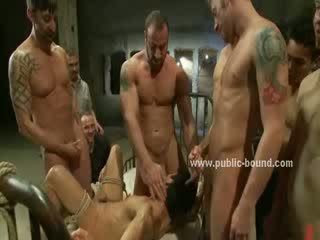 Blindfolded and tied up homo guy is used by several men, undressed and Peed On