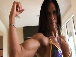 Sampurna fitness muscle woman flexing her strong ripped biceps