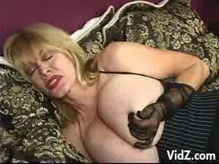 Mature model Patty Plenty plays with a Dildo