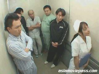 Petite Japanese nurse in elevator abuse
