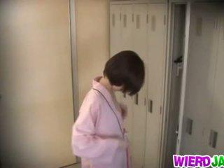 Wierd Japan: Cute Asian babes getting their boobs examined.