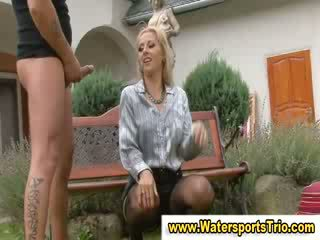 Piss clothed golden shower couple