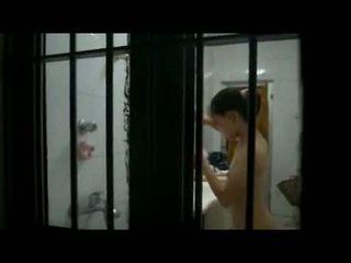 Hot Asian Teen Caught Showering By A Window Peeper