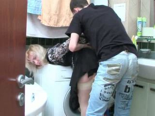 Mature blonde and teen boy has sex in bathroom