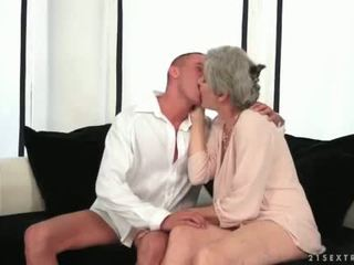 Busty grandma enjoying hot sex with her young love