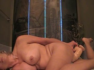 Hot mom blonde takes in a huge dildo Video
