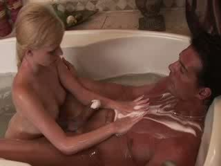 Horny guy is happy with his hot blond masseuse touching him