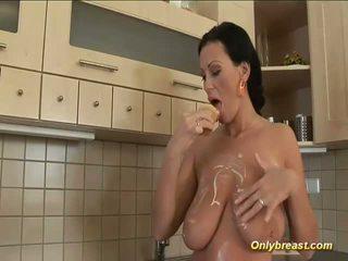 Big breasts milf squizing hard