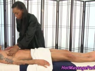 Ebony massage babe sucks client cock