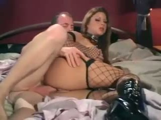 Monica Sweetheart - Sex in a corset sexy boots and fishnet stockings
