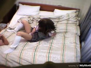 Japanese girl in a schoolgirl uniform, Junko, gets down for some erotic play