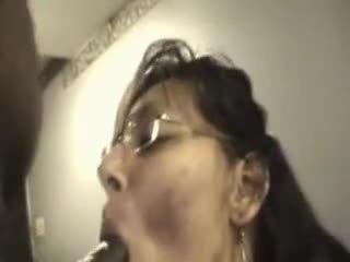 Mature woman sucks black cock