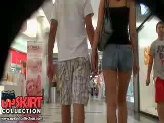 The hot denim jeans girl was walking with her bf but it didn
