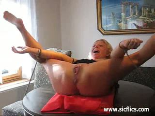 Pissing in the wifes fist fucked gaping vagina