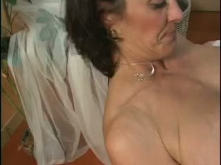 Hot MILF using a dildo