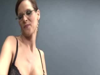 Sexy busty mature with glasses jacking cock and receives cumload on her face