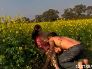 Curvy brunette fucks in a flower field