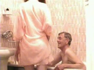 Old Man And Young Girl Bathing