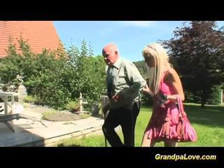 Blonde teen rides a very old man