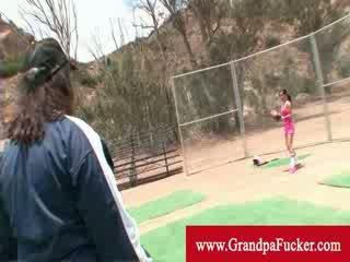 Delightful brunette learning baseball