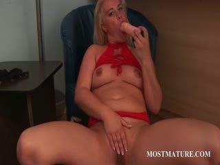 Bitchy Blond mature riding big toy