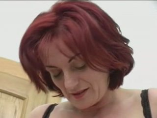 Redhead granny-beauty silit on stairs