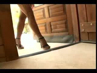 Jayna O plays with her puss while wearing Lolly Pop and heels