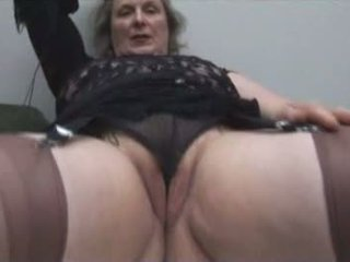 Busty granny in stockings shows off plump cameltoe