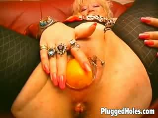Busty MILF inserting fruits, vegetables and big bottles in her sweet pussy