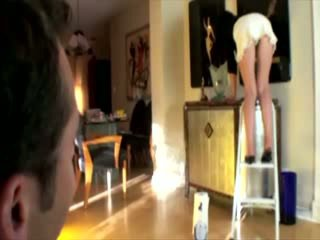 Cleaning housewife on ladder gives peek
