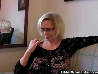 Perverted granny pushes her fist up her old cunt