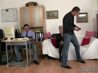 Old blondinke enjoys two cocks