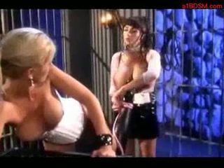 Blonde girl in corset licking mistress huge tits getting her