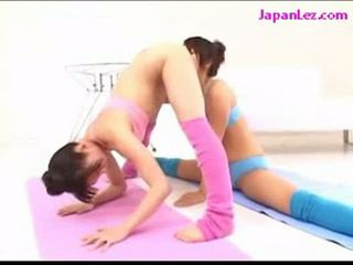 2 girls in aerobic dress licking pussies fucking with strapo