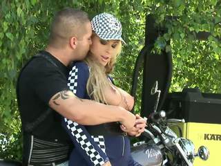 Busty biker babe with tattoted tits has an out door fuck