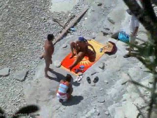Sunbathing Beach Sluts Have Some Teen Group Sex Fun