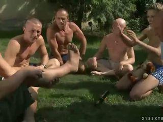 Five guys pissing on beautiful girl