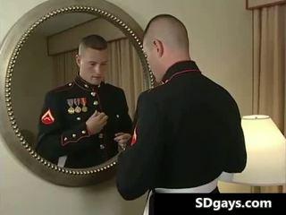 Soldier gay guy gets in full uniform