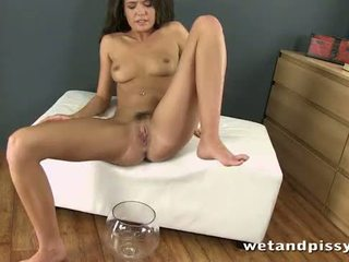 Horny brunette Tiffany Fox uses an anal butt plug while pissing in her own mouth