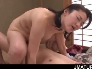 Cock riding mature Asian babe gets hairy twat nailed