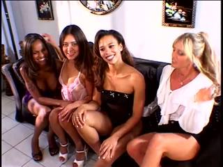 Four sexy bitches enjoy the interracial pussy licking and fingering on the couch
