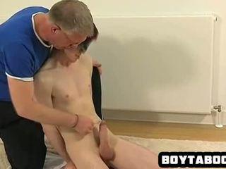 Blindfolded hunk sucks cock
