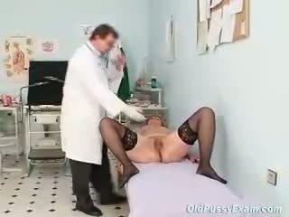 Redhead granny dirty pussy stretching in gyn clini