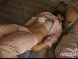 Asian girl in pijama masturbating licking and fingering othe