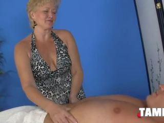 Breasty Mature Blonde Giving a Handjob
