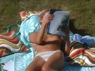 Spying On A Girl Sunbathing