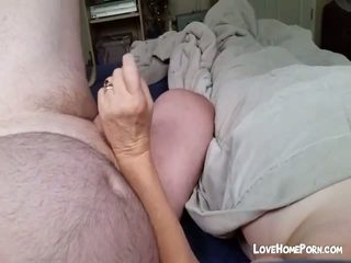 Big tited wife is jerking her husband's soft dick