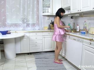 Pretty & pregnant babe fucks in the kitchen
