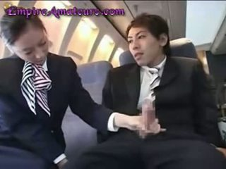 Japanese Stewardess Assists Man