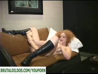 Blonde playing with many brutal dildos